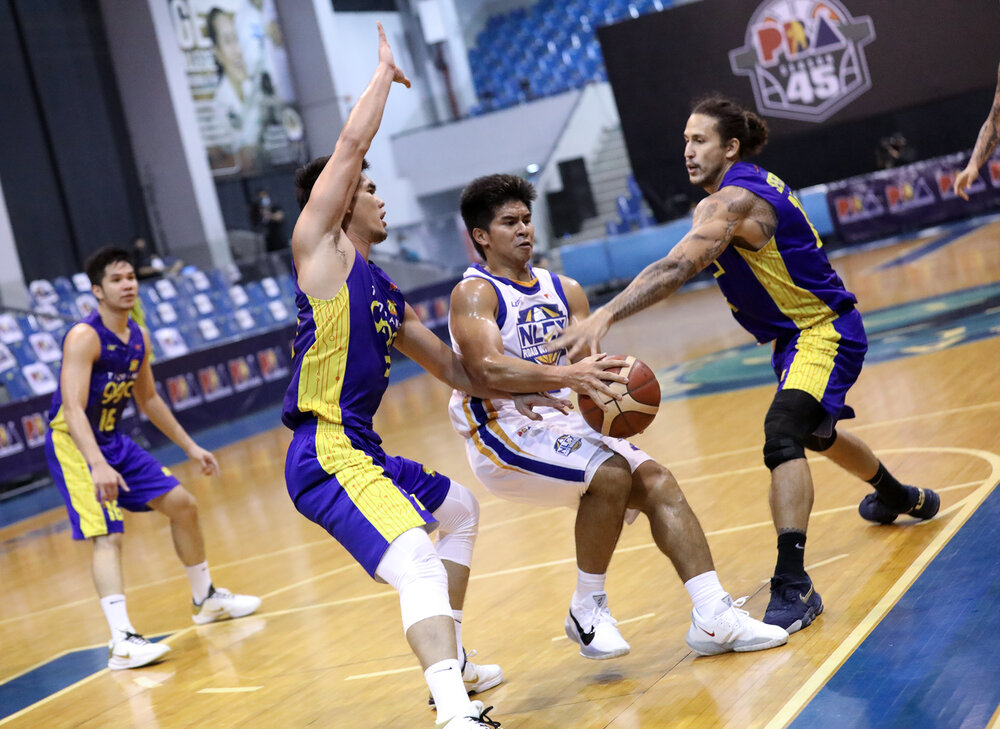NLEX's Kiefer Ravena protects the ball from two TNT defenders. (Photo from PBA)