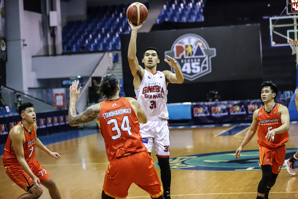 Ginebra's Aljon Mariano attempts a floater over Christian Standhardinger of NorthPort. (Photo from PBA)