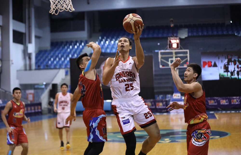 Ginebra's Japeth Aguilar goes for a lay-up against two Rain or Shine defenders. (Photo from PBA Media Group)
