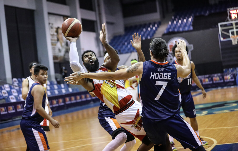 San Miguel's Mo Tautuaa gets creative against Cliff Hodge of Meralco. (Photo from PBA)