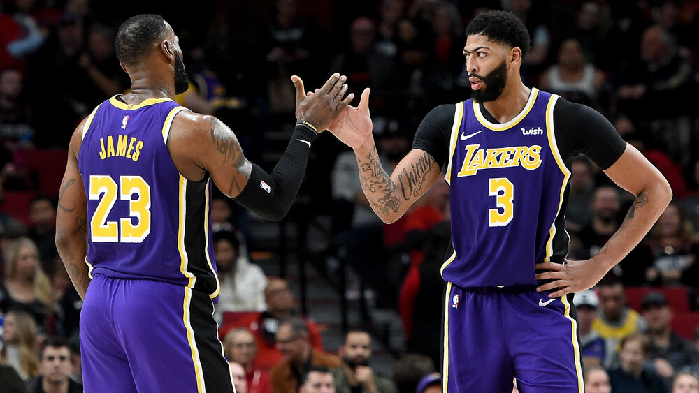 Lakers' stars LeBron James and Anthony Davis combined for 79 points in the series clincher against Portland. (Photo from Getty Images)
