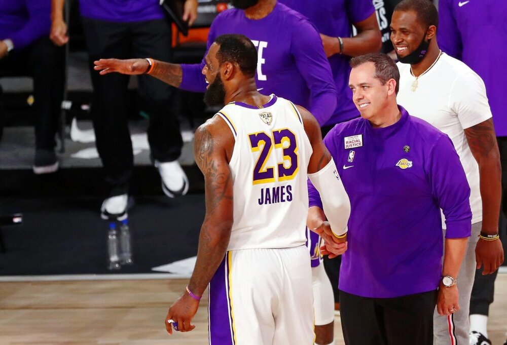 Lakers star LeBron James and head coach Frank Vogel share a laugh in the Orlando bubble. (Photo by Mike Ehrmann/AP)