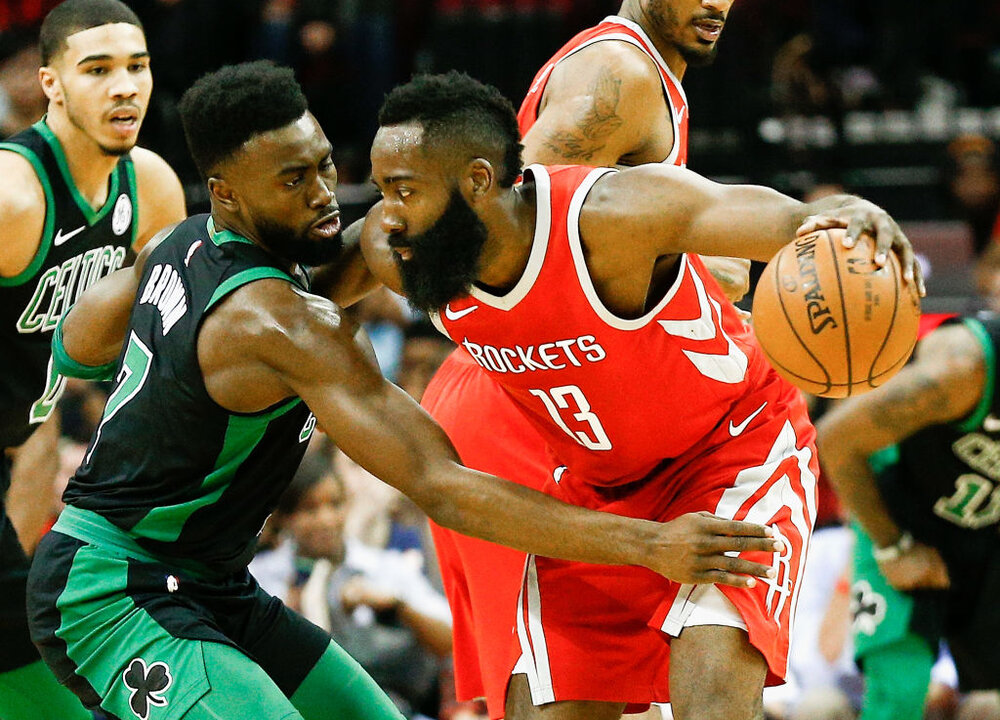 Rockets' James Harden making a move against Jaylen Brown and Jayson Tatum of the Celtics. (Photo by Bob Levey/Getty Images)