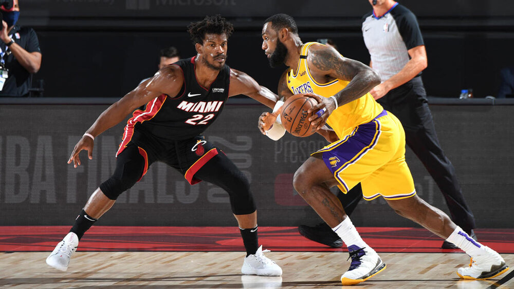 LeBron James and Jimmy Butler battling against each other during the Lakers-Heat Finals match-up. (Photo by Andrew D. Bernstein/NBAE/Getty Images)