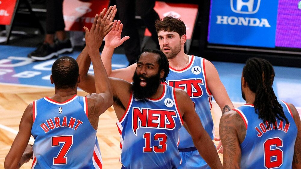Harden and Durant led the Nets to their fourth consecutive win. (Photo via Daily News)