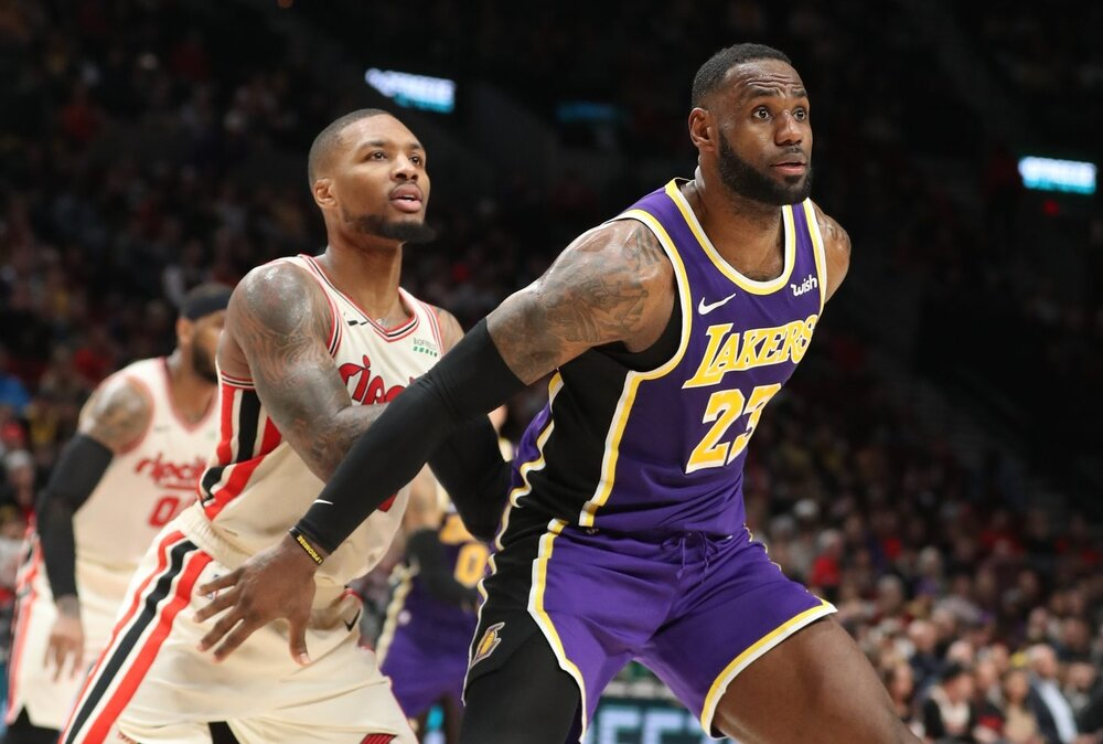 LeBron James and Damian Lillard will be going up against each other for the second time this season. (Photo via Essentially Sports)
