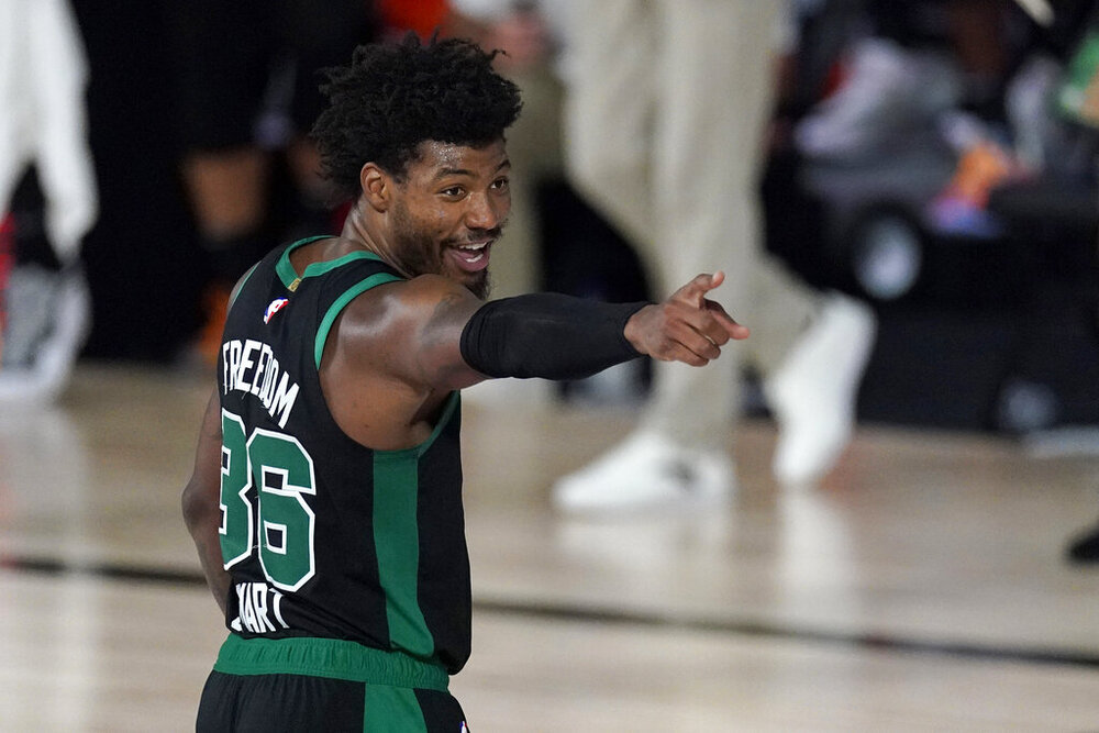 Marcus Smart's all-around play helped Boston take Game 3 in their Eastern Conference Finals match-up against Miami. (Photo by Mark J. Terrill/AP)