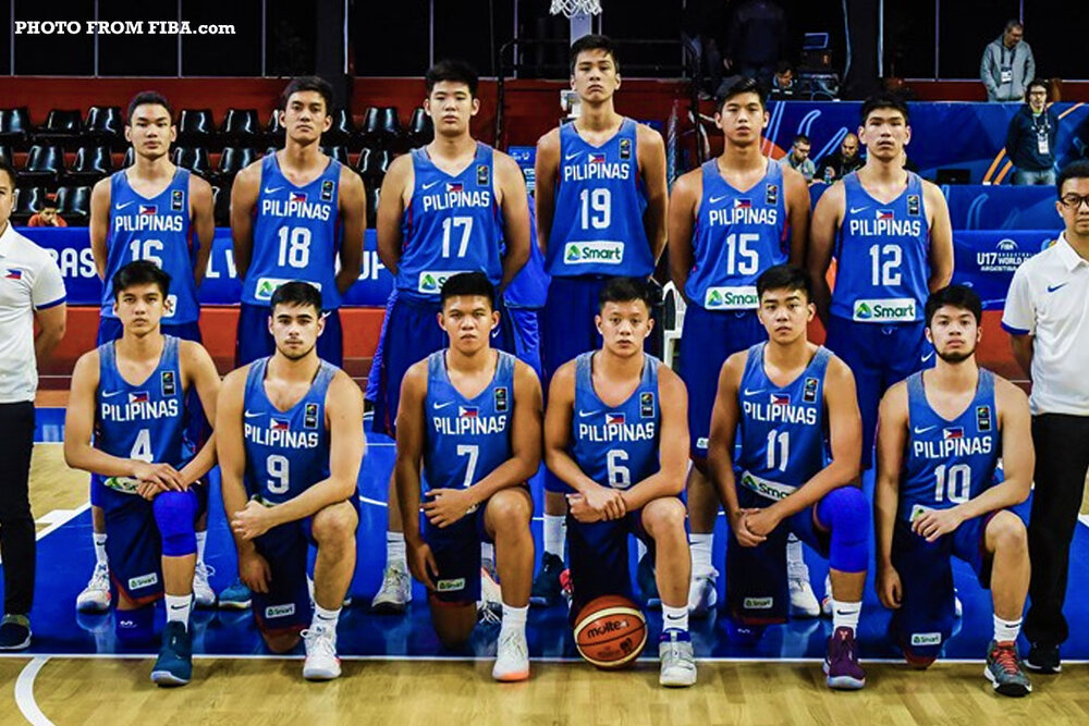 Yukien (wearing jersey number 12) with his Batang Gilas teammates in 2018. (Photo via FIBA)