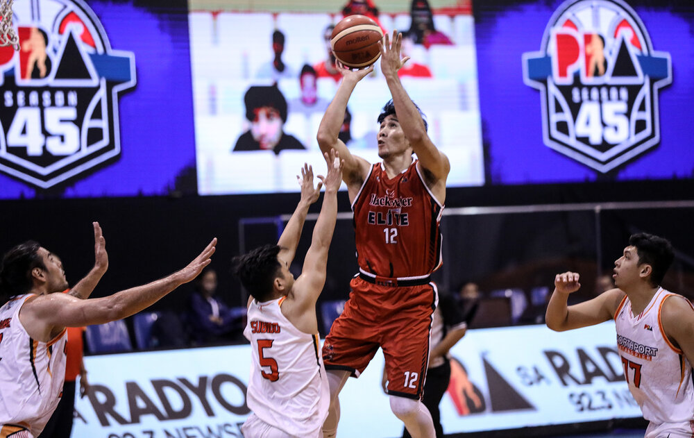 Blackwater's Mac Belo attempts a jumper over the outstretched arms of NorthPort's Renz Subido. (Photo from PBA)