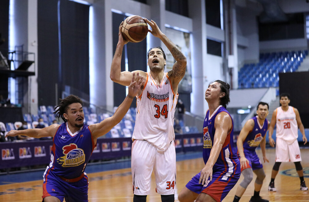 NorthPort's Christian Standhardinger scores against Sangalang and Justin Melton of Magnolia. (Photo from PBA)
