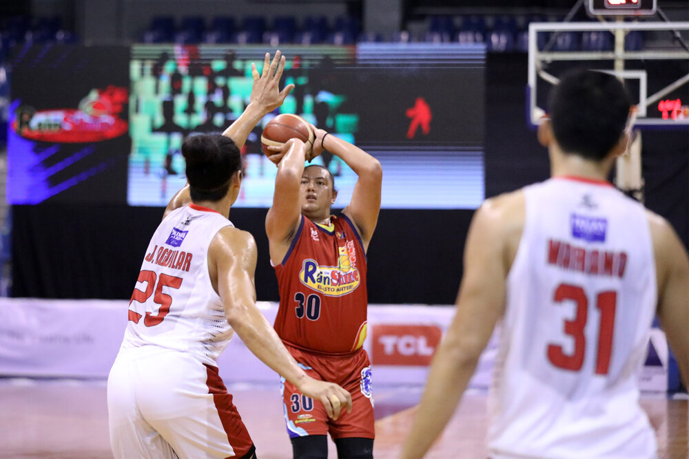 Rain or Shine's Beau Belga attempts a three-pointer against Aguilar. (Photo from PBA Media Group)