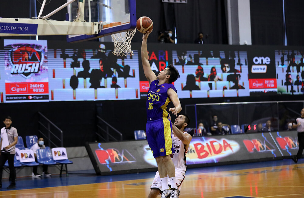 TNT's RR Pogoy makes a transition lay-up over Blackwater's Frank Golla. (Photo from PBA)