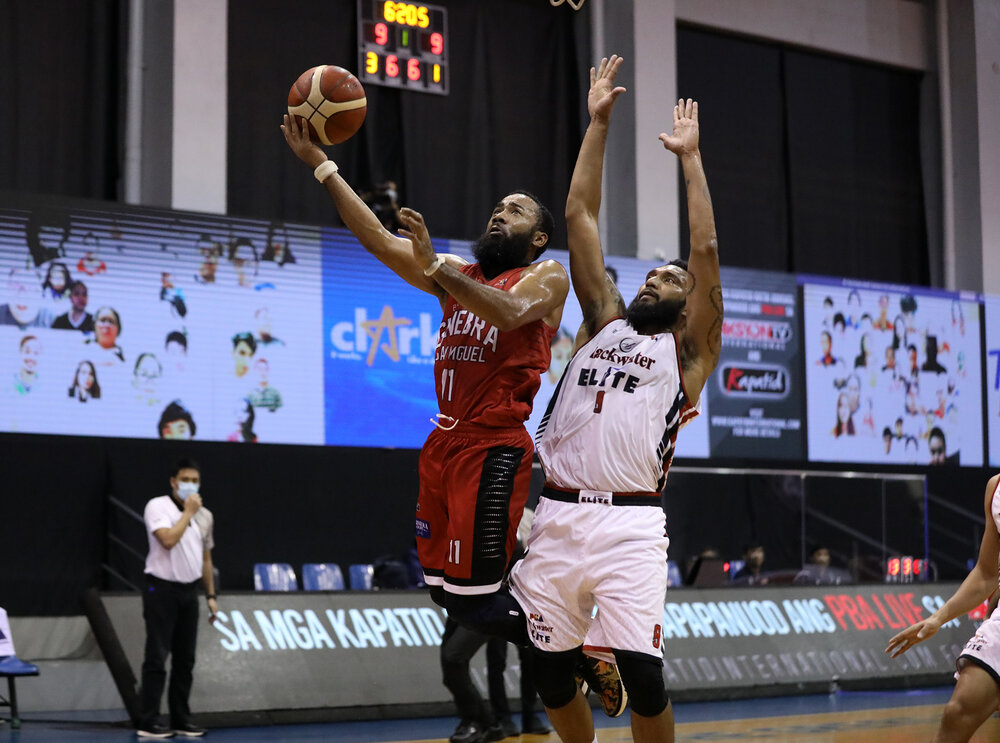 Stanley Pringle goes for a creative finish over Blackwater veteran KG Canaleta. (Photo from PBA)