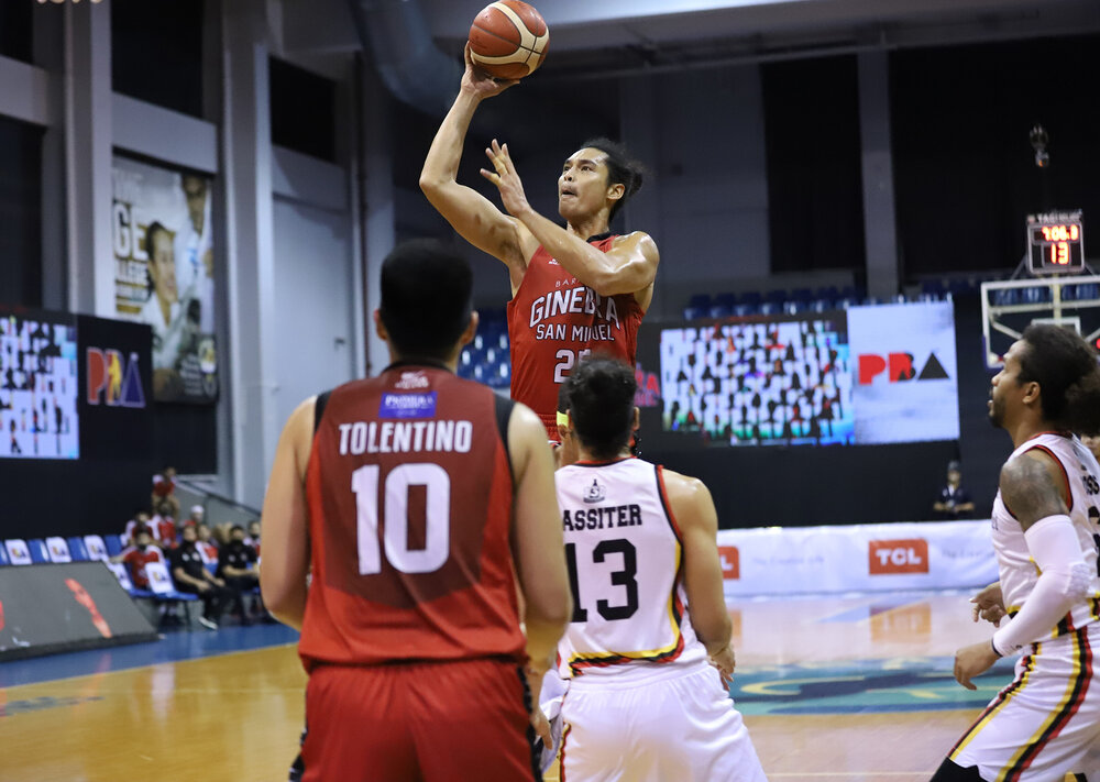 Ginebra's Japeth Aguilar attempts a floater against Marcio Lassiter of San Miguel. (Photo from PBA)