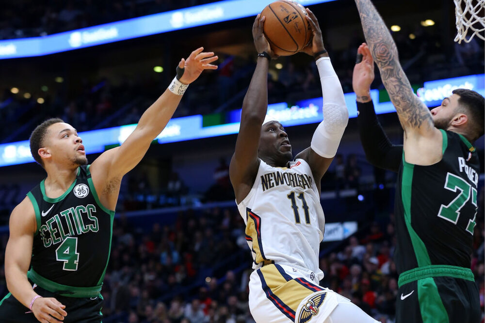 Jrue Holiday would make the Celtics a more complete team. (Photo by Jonathan Bachman/Getty Images)