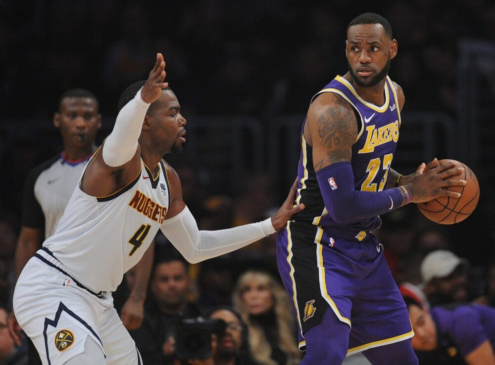 Paul Millsap guarding LeBron James during a Lakers-Nuggets match-up. (Photo from USA TODAY Sports)