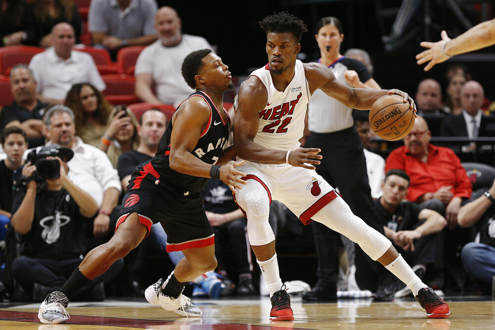 Kyle Lowry and Jimmy Butler could team up in Miami. (Photo by Michael Reaves/Getty Images)