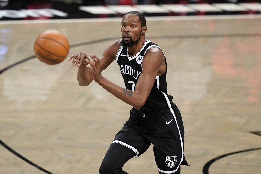 Kevin Durant is averaging a team-high 28.2 points per game for the Nets this season. (Photo by Kathy Willens/AP)
