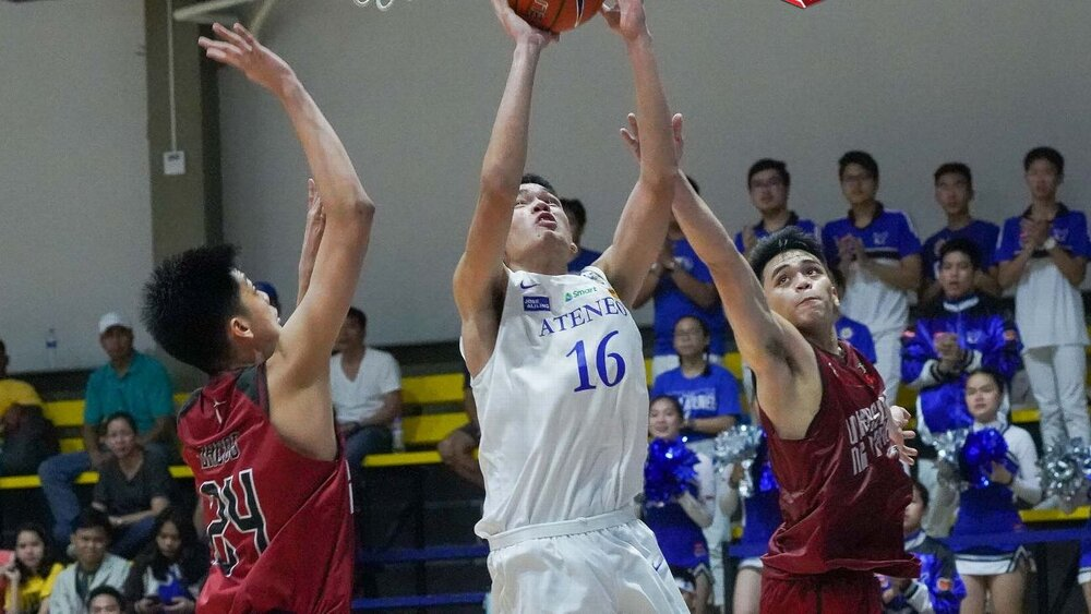 Lazaro going up for a shot inside the paint against two UP defenders. (Photo via ESPN)