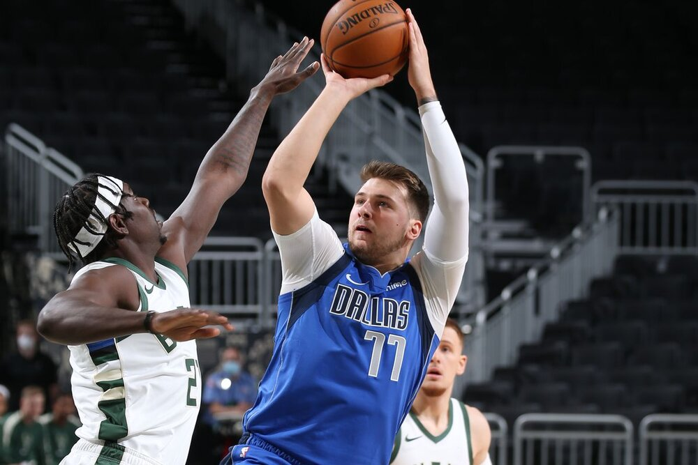 Luka Doncic attempting a jumper over Jrue Holiday of Milwaukee. (Photo via SB Nation)