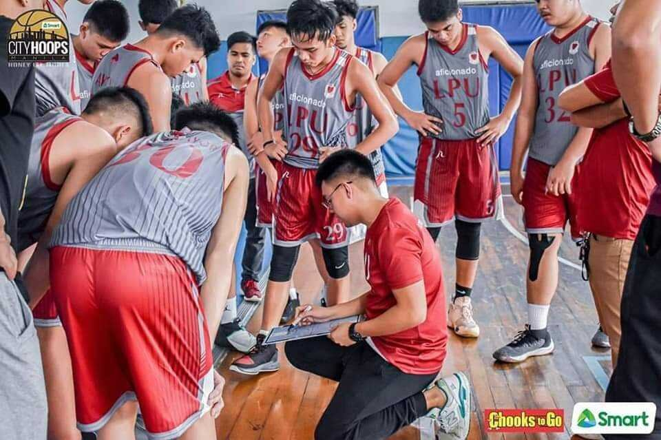 Coach Patrick drawing up a play for the LPU Cavite Junior Pirates