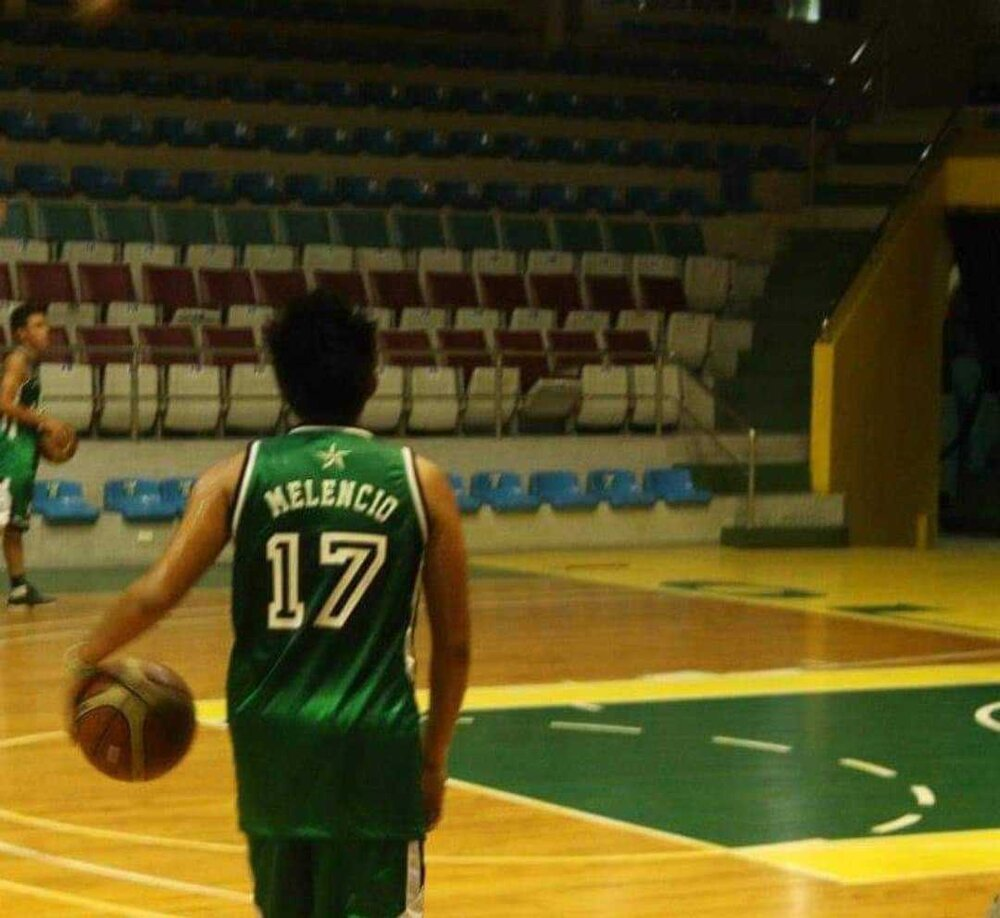 Coach Patrick donning the DLSU-D Patriots jersey during his collegiate years