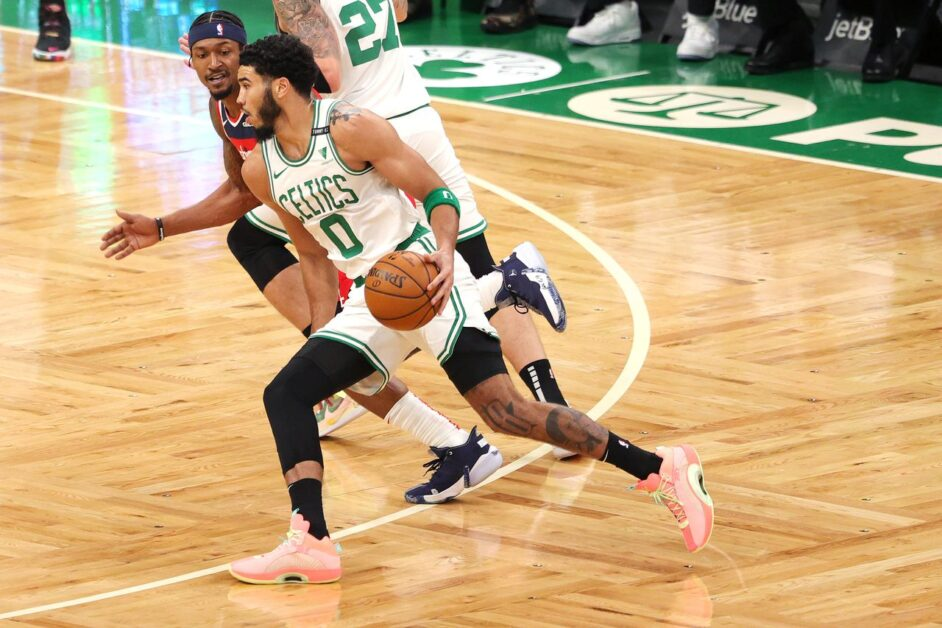 Jayson Tatum drives past Bradley Beal. (Photo by Maddie Meyer/Getty Images)